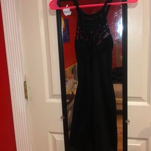 Tight Black dress with Beautiful Details on Front